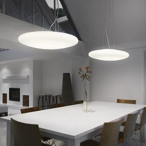Dining table, sofas and skylights in open dining and living area of modern house